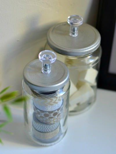 March Pinterest Challenge: DIY Storage Jars for less than $1. All you need are empty glass jars, IKEA Skatta Knobs and Spray Paint.
