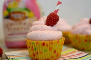 Raspberry Cupcakes with Berry Lemonade Frosting: Moist, sweet cupcakes topped with tangy berry lemonade frosting. It's like taking a big swig of lemonade with every bite. #PourMoreFun #ad #CollectiveBias