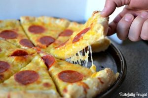 Pretzel Crust Pizza: Soft pretzels and pepperoni pizza unite to make this delicious meal! http://www.tastefullyfrugal.org