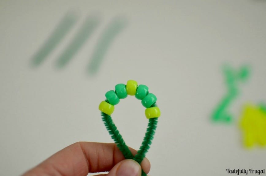 Four Leaf Clover Kids Craft: A Fun St. Patrick's Day Activity that helps develop fine motor skills, hand-eye coordination and pattern recognition | Tastefully Frugal